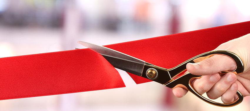 grand opening ribbon cutting ta